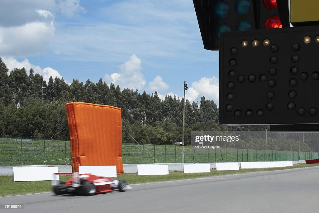 Racecar racing on a motor racing track : Foto de stock