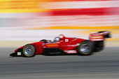 Racecar, side view (blurred motion, Digital Composite)