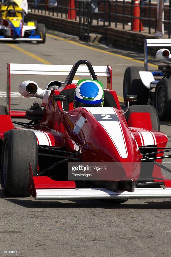 Racecars racing on a motor racing track : Foto de stock
