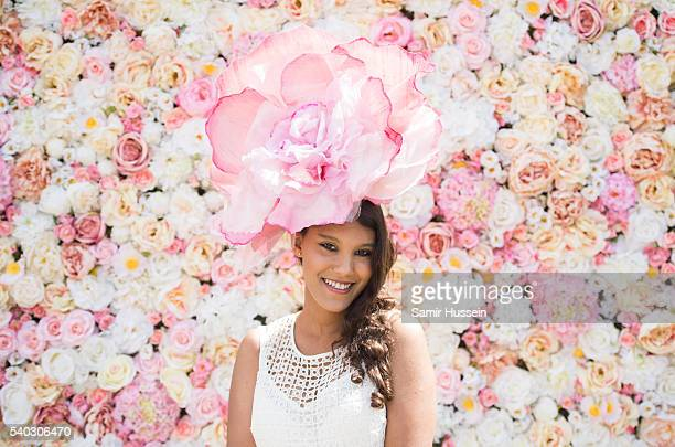 A racegoer arrives for day 2 of Royal Ascot at Ascot Racecourse on June 8 2016 in Ascot England