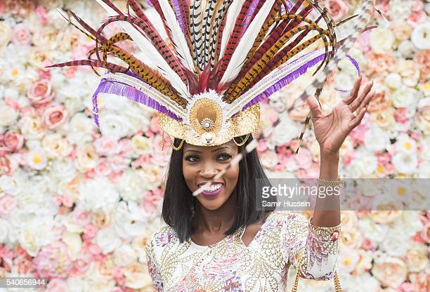 A racegoer arrives for day 3 of Royal Ascot at Ascot Racecourse on June 16 2016 in Ascot England