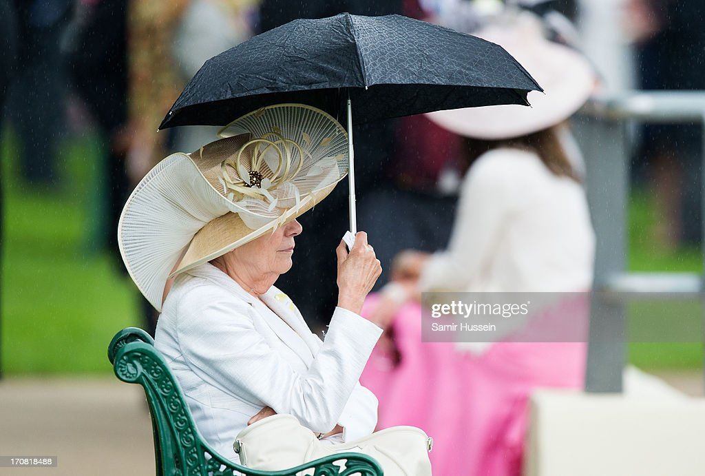 A racegoer attends day 1 of Royal Ascot at Ascot Racecourse on June 18, 2013 in Ascot, England.