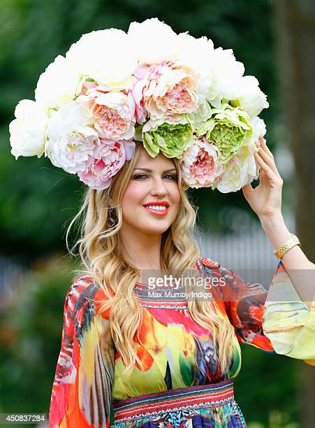 A racegoer attends Day 2 of Royal Ascot at Ascot Racecourse on June 18 2014 in Ascot England