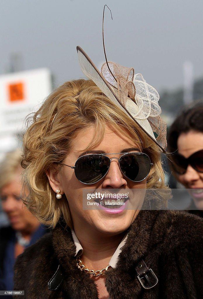 A racegoer attends day 4 of The Cheltenham Festival at Cheltenham Racecourse on March 14, 2014 in Cheltenham, England.