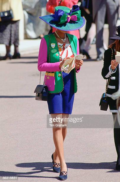 Racegoer attends Ladies Day at Ascot Races Surrey United Kingdom