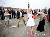 A racegoer celebrates as she attends day 2 'Ladies Day' of the Crabbie's Grand National Festival at Aintree Racecourse on April 10 2015 in Liverpool...