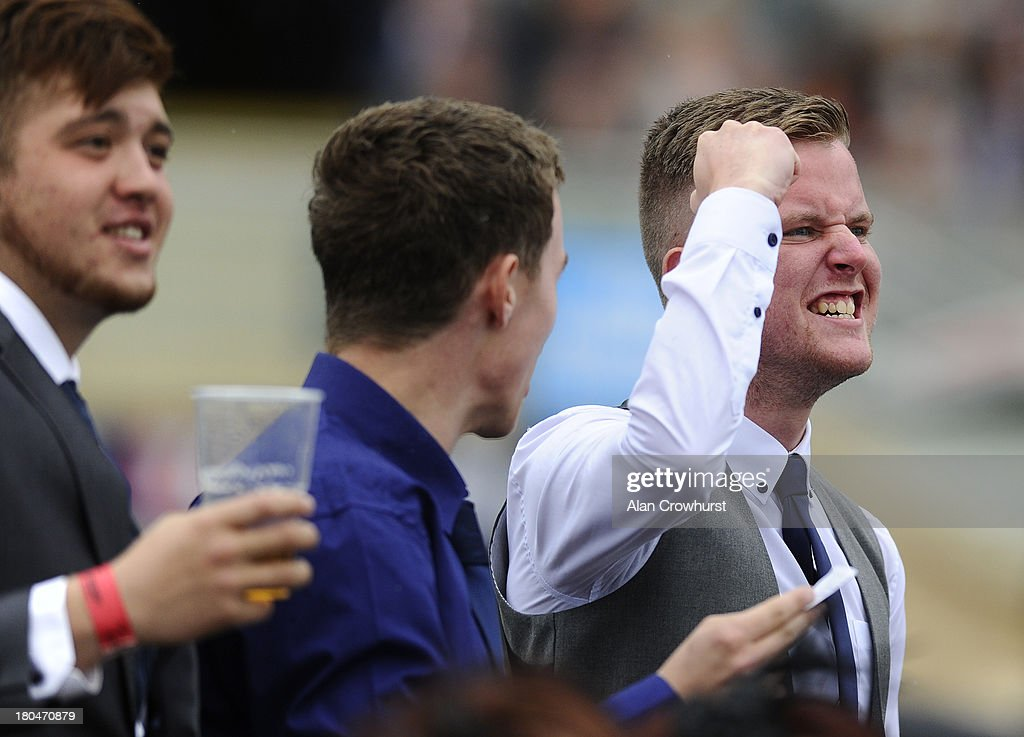 A racegoer cheers home a winner at Doncaster racecourse on September 13, 2013 in Doncaster, England.