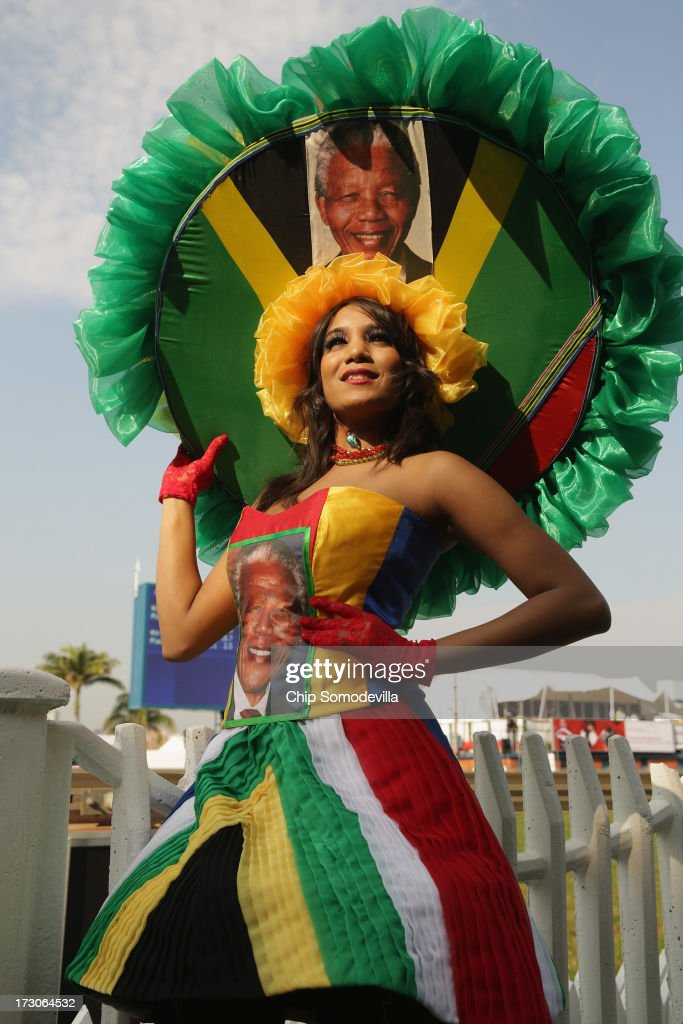 A racegoer dons a Nelson Mandela-inspired dress and hat while participating in a fashion competition during the Durban July horse races July 6, 2013 in Durban, South Africa. South Africa's premier horse racing event, the 2200-meter Durban July is held annually on the first Saturday of July since 1897 and offers a purse of 2.5 million Rand or about US $245,000.
