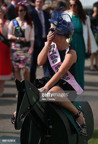 A racegoer enjoys the atmosphere during Ladies Day at Aintree Racecourse on April 10 2015 in Liverpool England