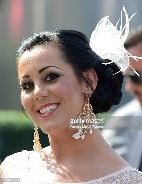 A racegoer enjoys the atmosphere on Day 1 of the Aintree races at Aintree Racecourse on April 9 2015 in Liverpool England