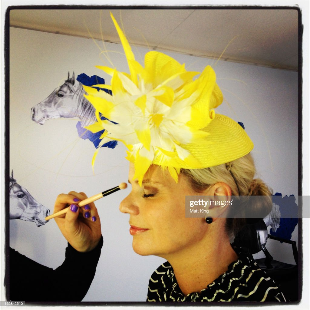 A racegoer has make-up applied during Crown Oaks Day at Flemington Racecourse on November 8, 2012 in Melbourne, Australia.