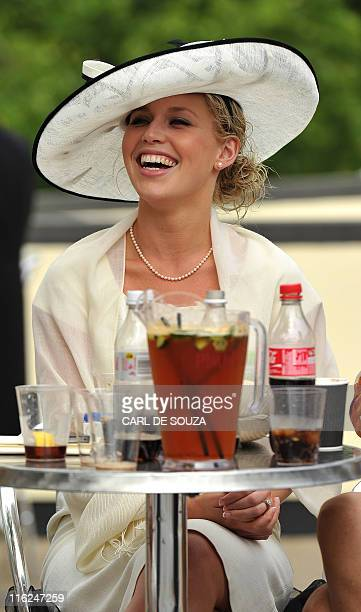 A racegoer is pictured with a jug of pimms on the second day of the annual Royal Ascot horse racing event near Windsor Berkshire west of London on...