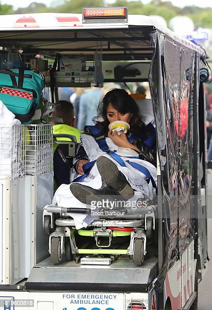 A racegoer is transported in the back of an ambulance following 2016 Melbourne Cup Day at Flemington Racecourse on November 1 2016 in Melbourne...