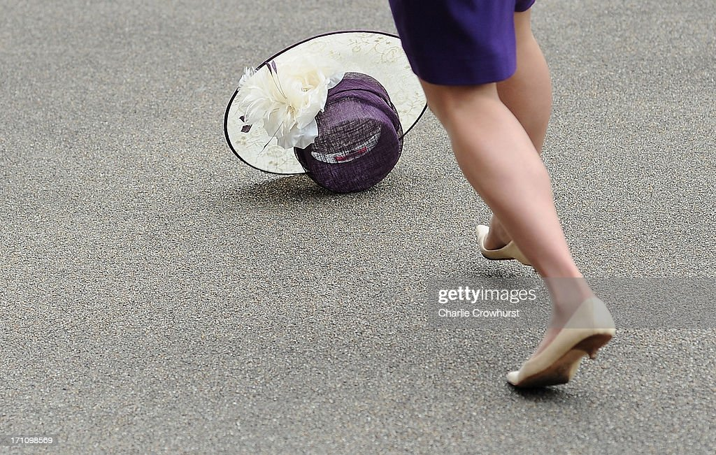 A racegoer loses her hat in a gust of wind during day five of Royal Ascot at Ascot Racecourse on June 22, 2013 in Ascot, England.
