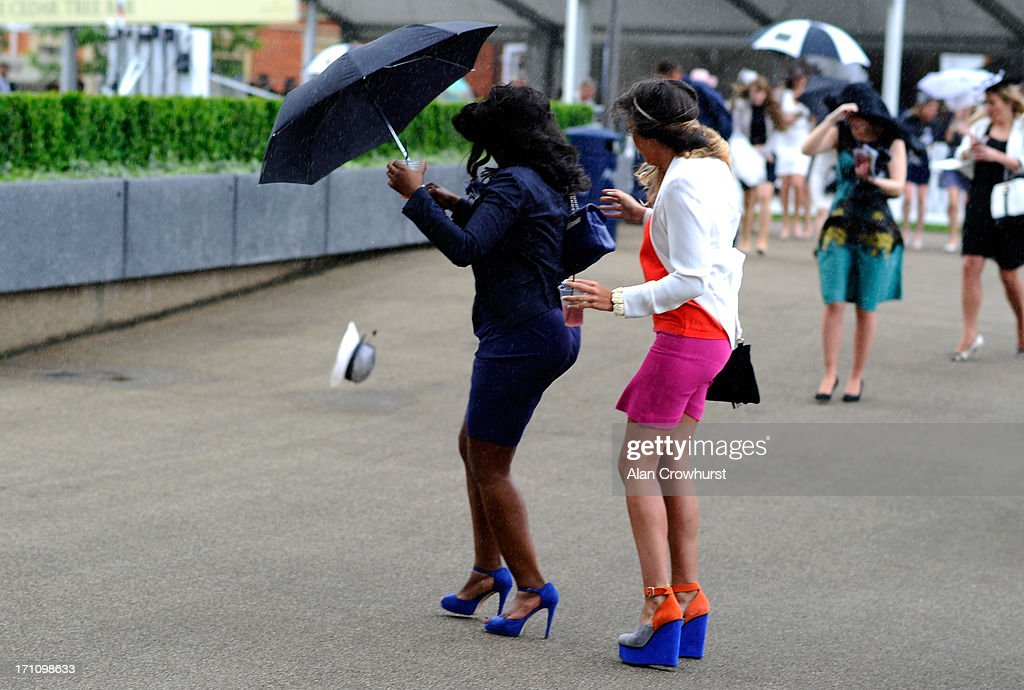 A racegoer loses her hat in a strong gust of wind during day five of Royal Ascot at Ascot Racecourse on June 22, 2013 in Ascot, England.
