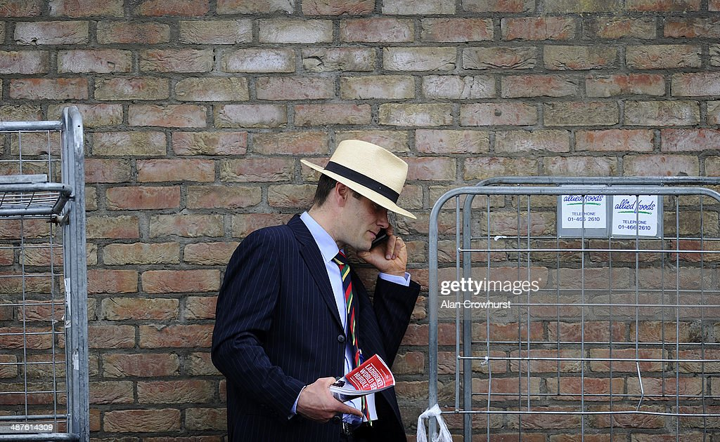 A racegoer makes a phone call in private at Punchestown racecourse on May 01, 2014 in Naas, Ireland.