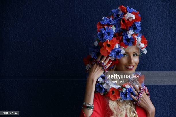 TOPSHOT Racegoer Natalia Beach dressed in a Union Flag themed outfit poses for a photgraph as she arrives to attend the fourth day of the Royal Ascot...