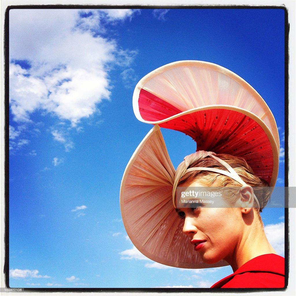 A racegoer poses during Crown Oaks Day at Flemington Racecourse on November 8, 2012 in Melbourne, Australia.