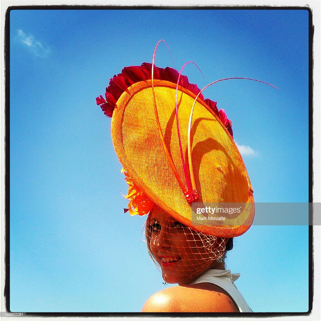 A racegoer poses during Crown Oaks Day at Flemington Racecourse on November 8, 2012 in Melbourne, Australia.