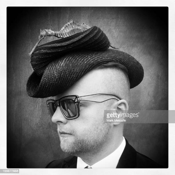 A racegoer poses during Melbourne Cup Day at Flemington Racecourse on November 6 2012 in Melbourne Australia