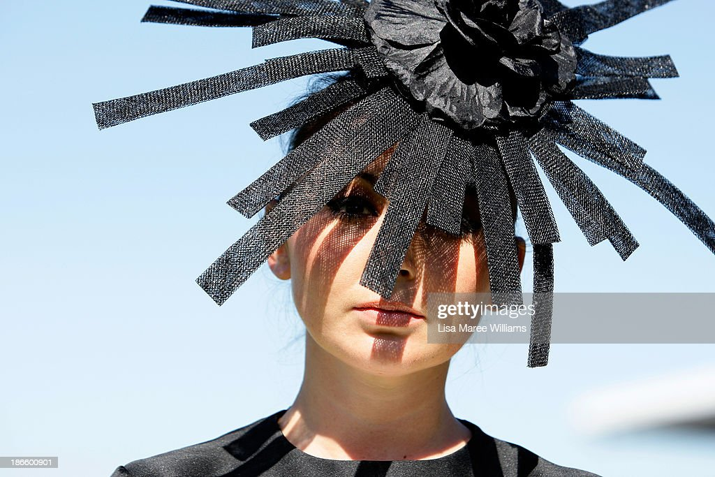A racegoer poses for a photo on Victoria Derby Day at Flemington Racecourse on November 2, 2013 in Melbourne, Australia.