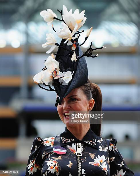 A racegoer poses for a photograph during Day Three of Royal Ascot 2016 at Ascot Racecourse on June 16 2016 in Ascot England