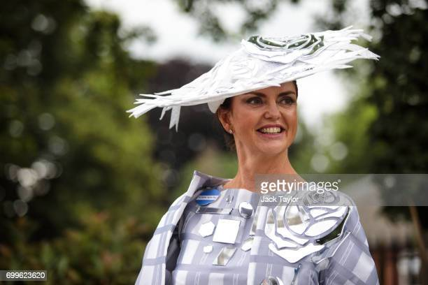 A racegoer poses for a photograph on day 3 of Royal Ascot at Ascot Racecourse on June 22 2017 in Ascot England The fiveday Royal Ascot meeting is one...