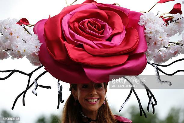 A racegoer poses for a picture during Ladies day at Royal Ascot in Ascot west of London on June 16 2016 The fiveday meeting is one of the highlights...