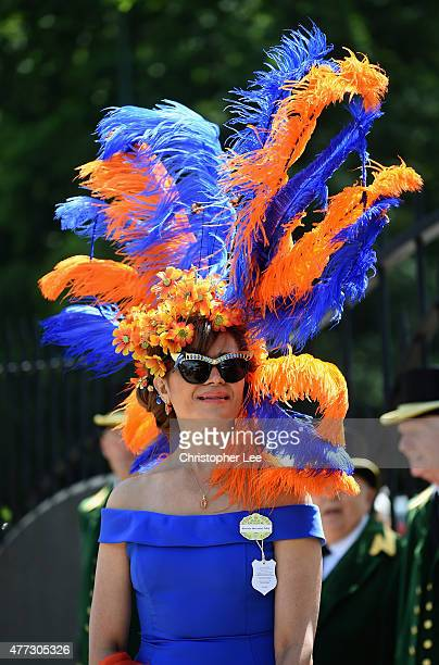 Racegoer poses for the camera during Day 1 of Royal Ascot 2015 at Ascot Racecourse on June 16 2015 in Ascot England