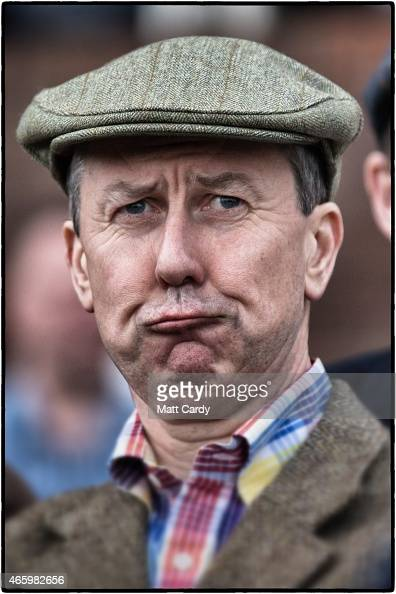 A racegoer reacts as he watches a race on the third day of the Cheltenham Festival on March 12 2015 in Cheltenham England Thousands of racing...