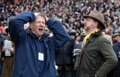 A racegoer reacts following the first race on Ladies Day at Cheltenham Racecourse on the second day of the Cheltenham Festival 2013 on March 13 2013...