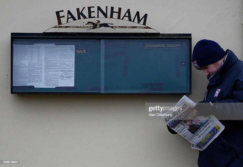 A racegoer reads the Racing Post at Fakenham racecourse on February 08, 2016 in Fakenham, England.