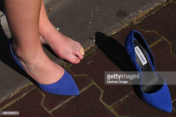 A racegoer rests her feet before race 1 on Melbourne Cup Day at Flemington Racecourse on November 3 2015 in Melbourne Australia