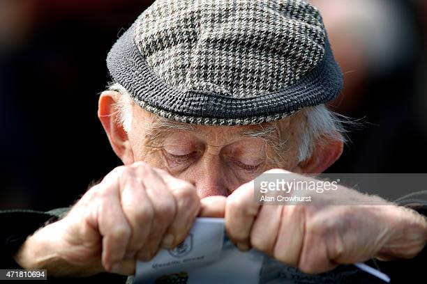 A racegoer studies his racecard at Punchestown racecourse on May 01 2015 in Naas Ireland