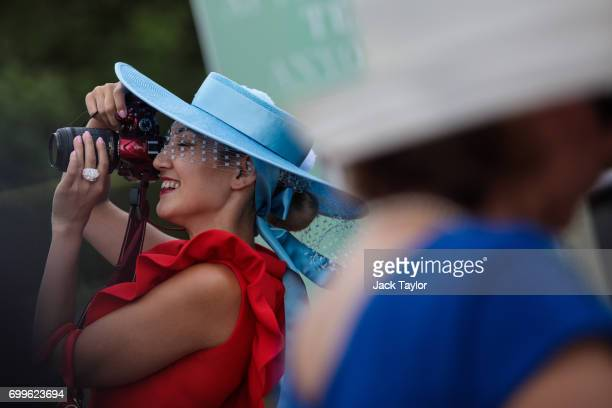 A racegoer takes a photo on day 3 of Royal Ascot at Ascot Racecourse on June 22 2017 in Ascot England The fiveday Royal Ascot meeting is one of the...