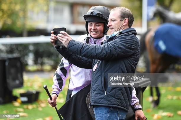 A racegoer takes a selfie with jockey Bryony Frost on race day at Ascot Racecourse on November 4 2017 in Ascot England