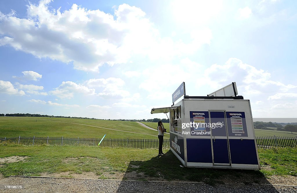 A racegoer visits a bookmaker stand in the Lonsdale enclosure at Epsom racecourse on August 27, 2013 in Epsom, England.