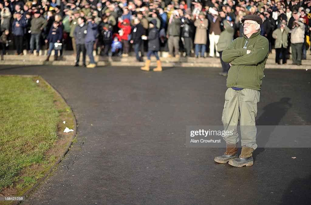 A racegoer watches the action during the last meeting to be held at Hereford racecourse after 241 years of racing on December 16, 2012 in Hereford, England.