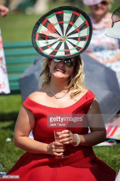 A racegoer wearing a dartboardshaped hat attends Royal Ascot 2017 at Ascot Racecourse on June 21 2017 in Ascot England The fiveday Royal Ascot...