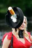 Racegoer wears a hat in the shape of a cigarette in an ashtray in traditional Ascot style to Ladies Day of Royal Ascot Races on June 21 2007 in Ascot...