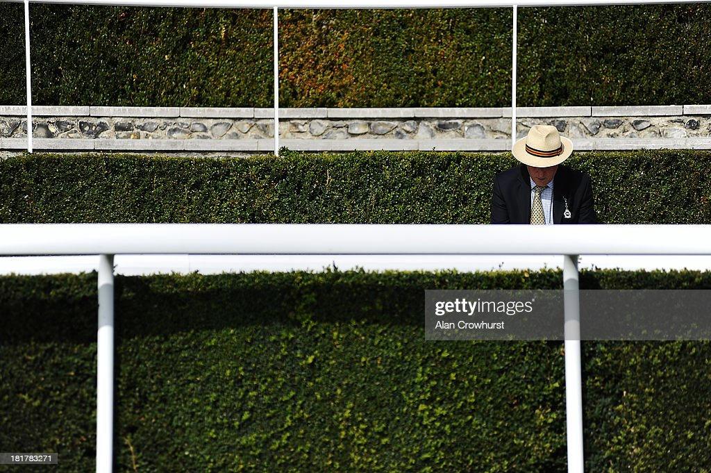 A racegoer wears a Panama hat on a warm day at Goodwood racecourse on September 25, 2013 in Chichester, England.