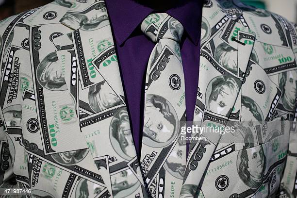A racegoer wears a suit patterned after one hundred dollar bills at Churchill Downs on the morning of the 141st Kentucky Derby in Louisville Kentucky...