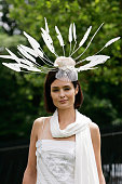 Racegoer wears a white feathered hat in traditional Ascot fashion style to Ladies Day of Royal Ascot Races on June 21 2007 in Ascot England