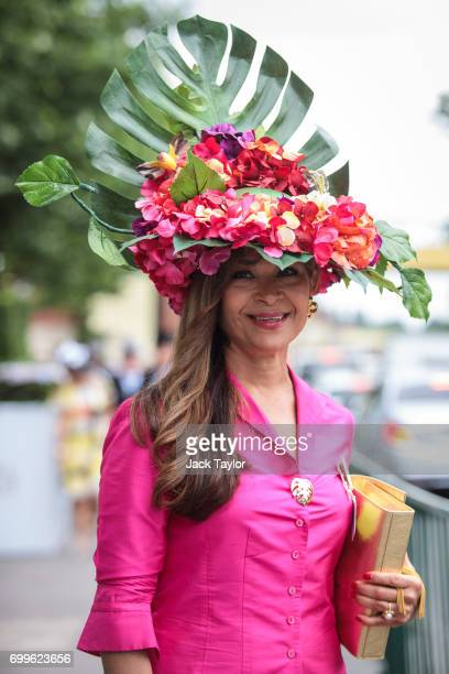 A racegoer with a floral themed hat poses on arrival on day 3 of Royal Ascot at Ascot Racecourse on June 22 2017 in Ascot England The fiveday Royal...