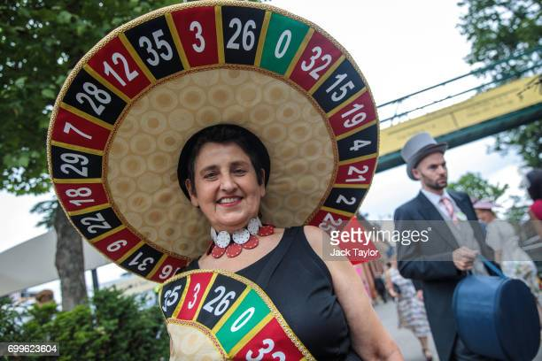 A racegoer with a roulettethemed hat poses for a picture on day 3 of Royal Ascot at Ascot Racecourse on June 22 2017 in Ascot England The fiveday...