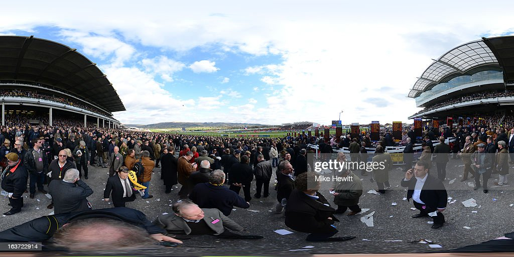 Racegoers and bookmakers gather in the stands during St Patrick's Thursday at Cheltenham racecourse on March 14, 2013 in Cheltenham, England.