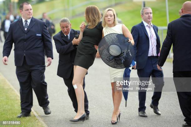 Racegoers are moved out of the road by security as they leave following day three of the Royal Ascot meeting at Ascot Racecourse Berkshire PRESS...