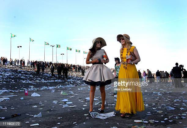 Racegoers are seen as they leave the racecourse after Ladies' Day at Aintree Racecourse on April 8 2011 in Liverpool England