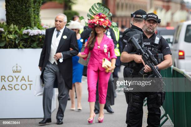 Racegoers arrive as armed police patrol outside on day 3 of Royal Ascot at Ascot Racecourse on June 22 2017 in Ascot England The fiveday Royal Ascot...