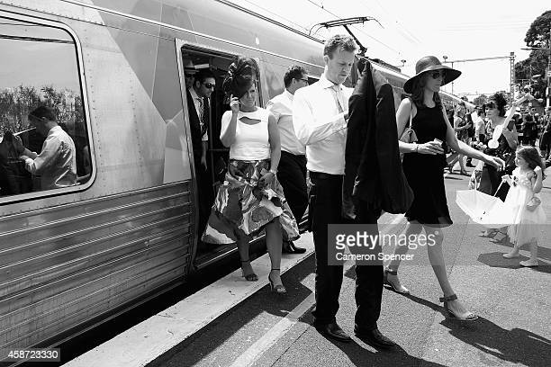 Racegoers arrive by train to Flemington station on Stakes Day at Flemington Racecourse on November 8 2014 in Melbourne Australia